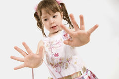 Adorable little girl stretching out hands Stock Photo