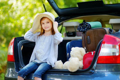 Adorable little girl in summer hat Stock Images