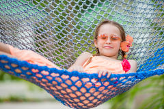 Adorable little girl on summer vacation relaxing in hammock Royalty Free Stock Images