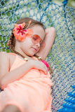 Adorable little girl on summer vacation relaxing in hammock Stock Image