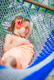 Adorable little girl on summer vacation sleeping in hammock Royalty Free Stock Photography