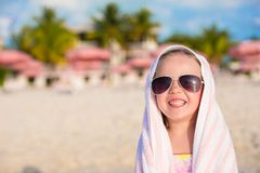 Adorable little girl in sunglasses covered with Stock Photography