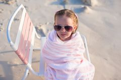 Adorable little girl in sunglasses covered with Stock Photo