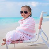 Adorable little girl in sunglasses covered with Royalty Free Stock Image