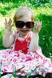 Adorable little girl in sunglasses - outdoors Royalty Free Stock Images