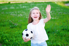 Adorable little girl supporting her national football team during soccer championship. Adorable girl supporting her national football team during soccer Stock Image