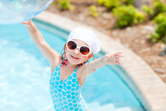 Adorable little girl at swimming pool Stock Images