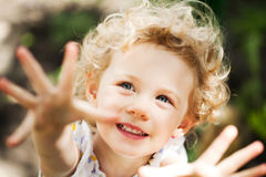 Adorable little girl taken closeup outdoors Royalty Free Stock Images