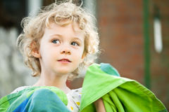 Adorable little girl taken closeup outdoors Stock Photo