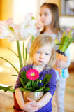 Adorable little girl taking care of plants and flowers Royalty Free Stock Images