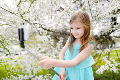 Adorable little girl taking a photo of herself Royalty Free Stock Images