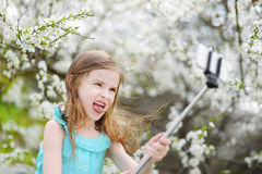Adorable little girl taking a photo of herself Stock Photography