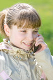 Adorable little girl talking by cellphone Royalty Free Stock Image