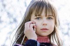 Adorable little girl talking by cellphone Royalty Free Stock Images