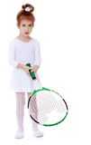 Adorable little girl with a tennis racket in hand Stock Images