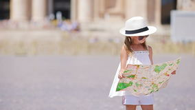 Adorable little girl with touristic map in St. Peter's Basilica square, Italy. Happy toodler kid enjoy italian vacation stock video
