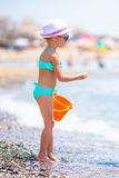 Adorable little girl with toy basket at beach during summer vacation Royalty Free Stock Images