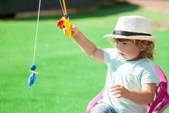 Adorable little girl fishing. stock photography