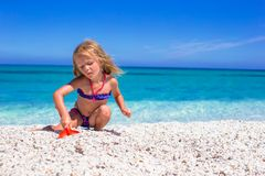 Adorable little girl at tropical beach during Royalty Free Stock Photography
