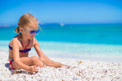Adorable little girl at tropical beach during Stock Photos