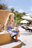 Adorable little girl at tropical beach royalty free stock photo
