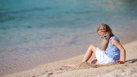 Adorable little girl at tropical beach during vacation. Adorable little girl at tropical beach on vacation stock footage