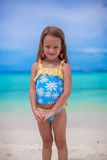 Adorable little girl on tropical beach vacation Stock Images