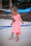 Adorable little girl on tropical beach vacation Stock Photos