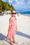 Adorable little girl on tropical beach vacation in Royalty Free Stock Photo