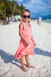 Adorable little girl on tropical beach vacation in Royalty Free Stock Image