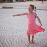 Adorable little girl on tropical beach vacation in Royalty Free Stock Photos
