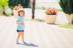 Adorable little girl at the tropical resort, sunny summer day. Adorable little girl at the tropical resort, walking at the hotel territory, sunny summer day stock photography