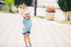 Adorable little girl at the tropical resort, sunny summer day. Adorable little girl at the tropical resort, walking at the hotel territory, sunny summer day stock photos