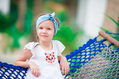 Adorable little girl on tropical vacation relaxing in hammock Royalty Free Stock Photo
