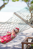 Adorable little girl on tropical vacation relaxing Royalty Free Stock Photography
