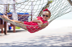 Adorable little girl on tropical vacation relaxing Stock Photography