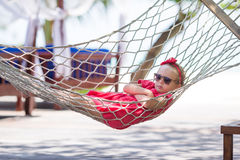 Adorable little girl on tropical vacation relaxing Royalty Free Stock Images