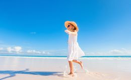 Adorable little girl at beach. Adorable little girl at tropical white sand beach royalty free stock photography