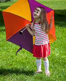 Adorable little girl with umbrella. Adorable little girl with colored umbrella outdoors Royalty Free Stock Images