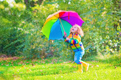 Adorable little girl with umbrella Royalty Free Stock Photography