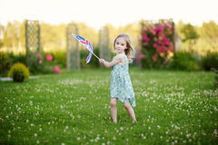 Adorable little girl with United Kingdom flag Stock Photography