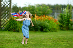 Adorable little girl with United Kingdom flag Royalty Free Stock Photography