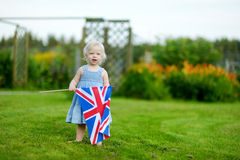 Adorable little girl with United Kingdom flag. Outdoors Royalty Free Stock Image
