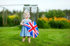 Adorable little girl with United Kingdom flag Stock Image