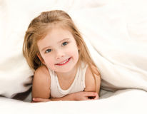 Adorable little girl waked up in bed Stock Image