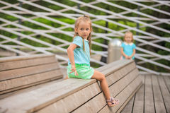 Adorable little girl walking outdoor and having fun in park Royalty Free Stock Photography