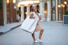 Adorable little girl walking with shopping bags in Paris outdoors Royalty Free Stock Images