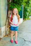 Adorable little girl walking on the stree Royalty Free Stock Photo