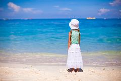 Adorable little girl walking on tropical white Royalty Free Stock Images