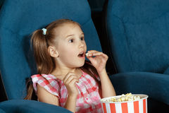 Adorable little girl watching movie Royalty Free Stock Images